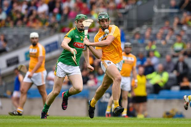Tight tussle: James Connolly of Antrim and Ronan Sherlock of Meath battle during the Christy Ring Cup final