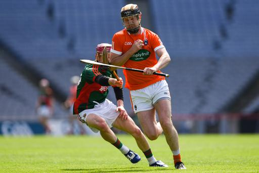 In battle: Cormac Toner of Armagh and Mayo's Joe McManus at Croker