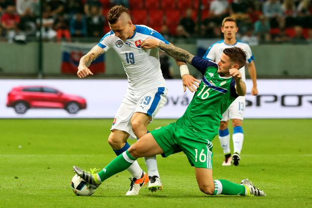 Tackle that: Oliver Norwood wins possession from Slovakia's Juraj Kucka
