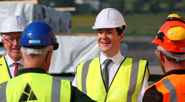 Chancellor George Osborne meets workers during a visit to Warrenpoint Harbour in Co Down, where he warned that Brexit would trigger a