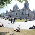 People enjoy the sunshine in the grounds of Belfast City as good weather continues across Northern Ireland. Picture by Jonathan Porter/PressEye