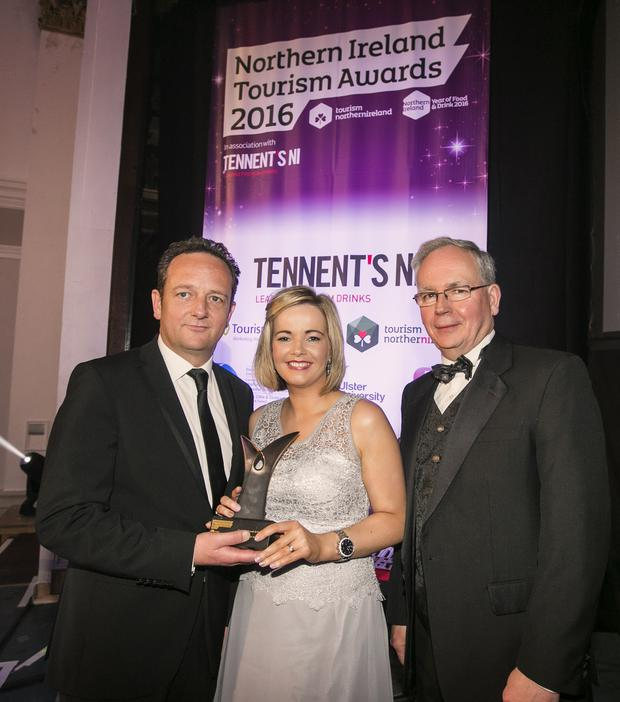 Paul Smyth and Lauren McAteer and Brendan Dowdall from First Trust Bank with the award for best hotel from the Northern Ireland Tourism Awards 2016.