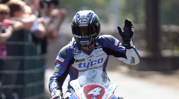Victory salute: Ian Hutchinson soaks up the applause after storming to victory on his Tyco BMW in the Superstock race at the Isle of Man