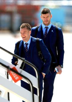 On his way: Leicester City striker Jamie Vardy boards the plane carrying the England team to the Euro 2016 finals in France with his club career up in the air after Arsenal triggered the escape clause in his contract