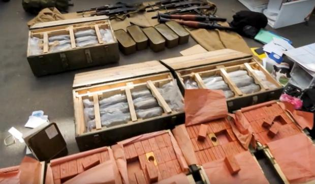 In this image, provided by the Ukrainian Intelligence Agency SBU on Monday, June 6, 2016, confiscated ammunition and explosives are on a display at the Yahodyn border crossing on the Ukrainian-Polish border, Ukraine. (Ukraine's Intelligence Agency SBU Press Service photo via AP)