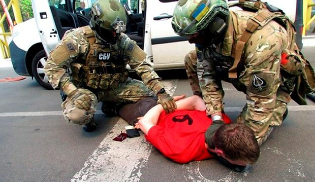 In this image, provided by the Ukrainian Intelligence Agency SBU on Monday, June 6, 2016, SBU agents detain a suspect at the Yahodyn border crossing on the Ukrainian-Polish border, Ukraine. (Ukraine's Intelligence Agency SBU Press Service photo via AP)