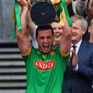 In the air: Meath's Joey Keena lifts the trophy but there was a counting error