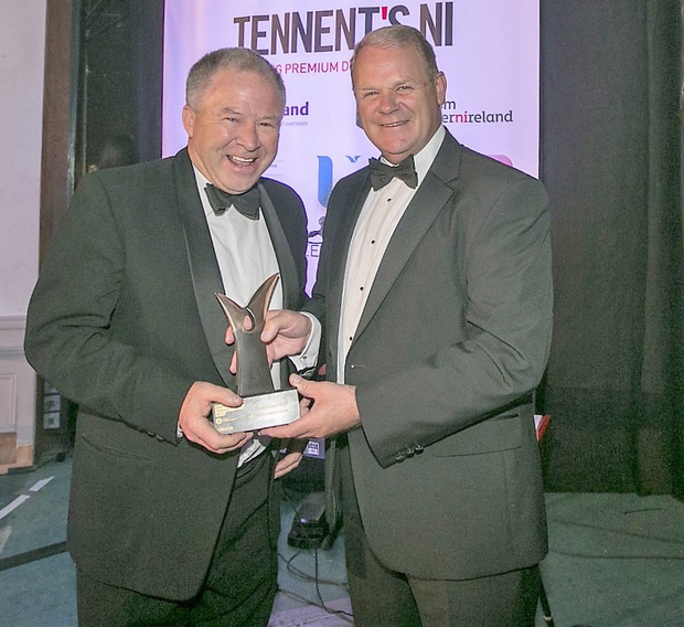 Rally great: Bobby Willis (left), Event Director of the Circuit of Ireland, collects the Best Event/Festival Experience Award from Brian Ambrose, Tourism Ireland Chairman, at the NI Tourism Awards in Londonderry