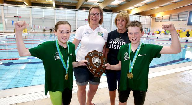 Joy: Ards captains Ellie Brown and Joshua Creaney celebrate alongside Ruth McQuillan of Swim Ulster and Maggie McKinstry of Forest Feast