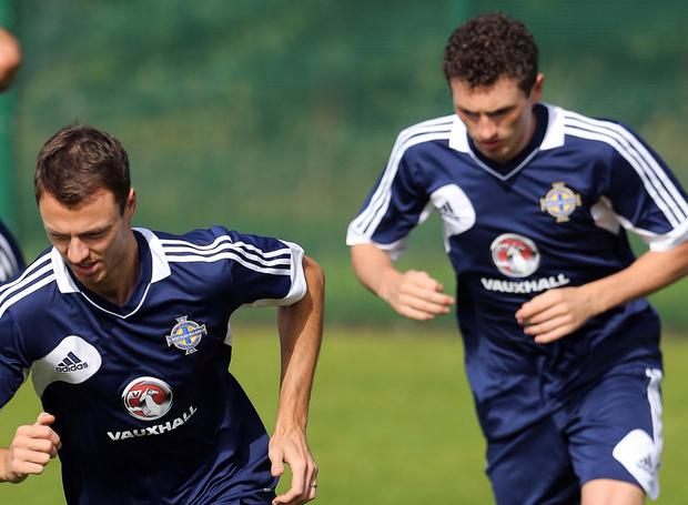 Brothers in arms: Corry (right) and Jonny Evans
