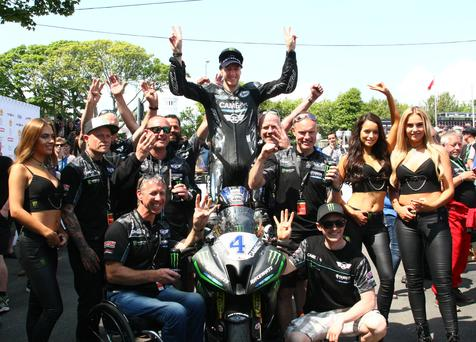 Treble yell: Ian Hutchinson celebrates his third win of the 2016 Isle of Man TT in the Supersport class and has plans to step it up a gear in the Senior TT race