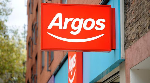 Argos owner Home Retail Group is setting aside at least £30m to compensate store card customers after overcharging late payment fees