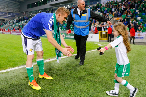 Superb journey: Steve Davis greets his eldest daughter Chloe after qualifying for Euro 2016