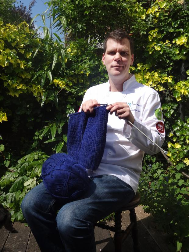 James McIntosh shows off his knitting skills