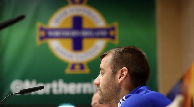 Big call: Niall McGinn at the Northern Ireland Press conference but he could have been playing in an Ulster Championship semi-final