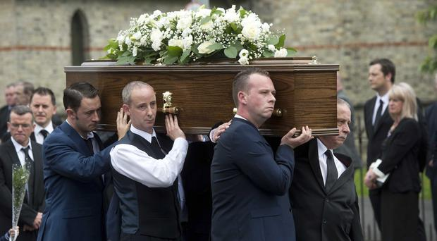 Former loyalist paramilitary and Progressive Unionist Party (PUP) chairman William 'Plum' Smith's funeral takes place from St Matthews Church of Ireland on the Woodvale road in Belfast.