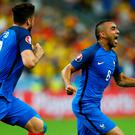 Dimitri Payet of France celebrates scoring his team's second goal during the UEFA Euro 2016 Group A match between France and Romania at Stade de France on June 10, 2016 in Paris, France. (Photo by Clive Rose/Getty Images)