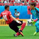 Switzerland's goalkeeper Yann Sommer (R) saves the ball in front of Albania's forward Armando Sadiku during the Euro 2016 group A football match between Albania and Switzerland at the Bollaert-Delelis Stadium in Lens on June 11, 2016. / AFP PHOTO / PHILIPPE HUGUENPHILIPPE HUGUEN/AFP/Getty Images
