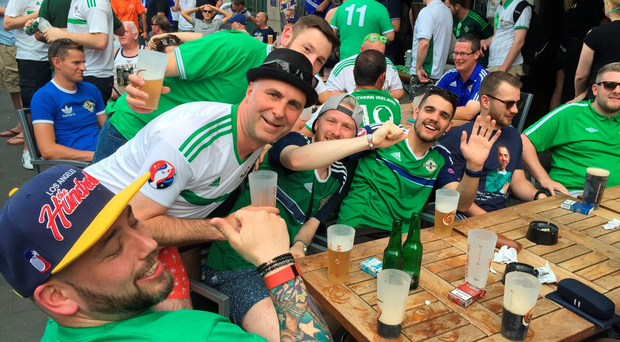 More peaceful times for Northern Ireland fans. Groom Stuart Stockman (second left) outside the Ma Nolan's Irish pub in Nice, France ahead of the opening match against Poland in Euro 2016. Michael McHugh/PA Wire