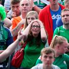 Northern Ireland fans look dejected whilst watching the UEFA Euro 2016, Group C match between Northern Ireland and Poland at the Titanic Museum, Belfast.