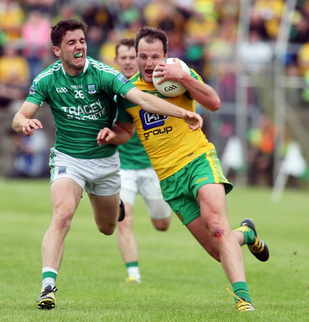 Close contact: Donegal's Michael Murphy is challenged by Fermanagh's Ryan Lyons
