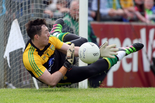 Foiled: Mark Anthony McGinley saves Sean Quigley's penalty