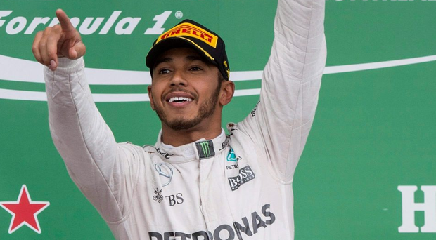 So sweet: Lewis Hamilton celebrates winning the Canadian Grand Prix