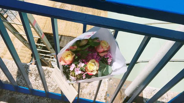 Flowers are left close to the scene where Darren Rodgers, from Ballymena, died after a fall in Nice in France. Michael McHugh/PA Wire