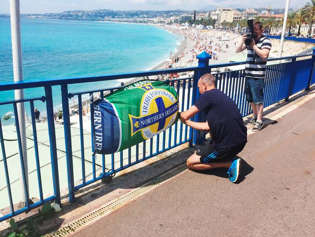 Flowers and a banner are left close to the scene where Darren Rodgers, from Ballymena, died after a fall in Nice in France.Michael McHugh/PA Wire