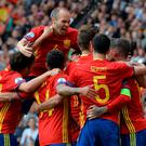 Spain's players celebrate after Spain's defender Gerard Pique scored the opening goal during the Euro 2016 group D football match between Spain and Czech Republic at the Stadium Municipal in Toulouse on June 13, 2016. / AFP PHOTO / NICOLAS TUCATNICOLAS TUCAT/AFP/Getty Images