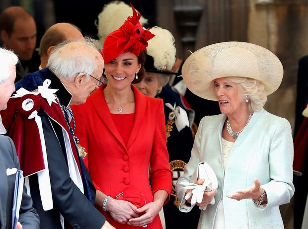 The Duchess of Cambridge (centre) and the Duchess of Cornwall talk to guests after attending the annual Order of the Garter Service at St George's Chapel, Windsor Castle. Chris Jackson/PA Wire
