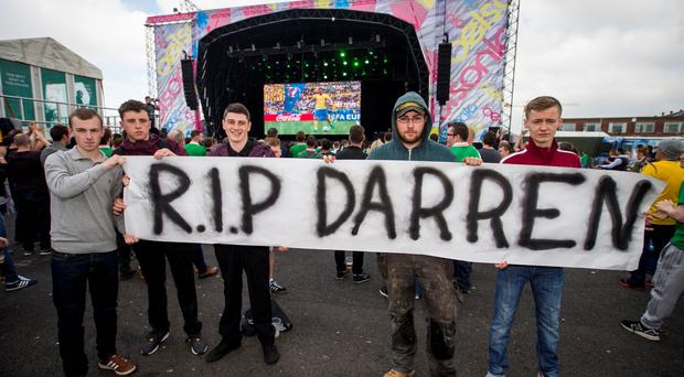 Republic of Ireland fans at the Titanic Fanzone unveil a banner in remembrance to Northern Ireland fan Darren Rodgers who died yesterday after a tragic accident while in Nice, France supporting the team. Picture by Liam McBurney/RAZORPIX