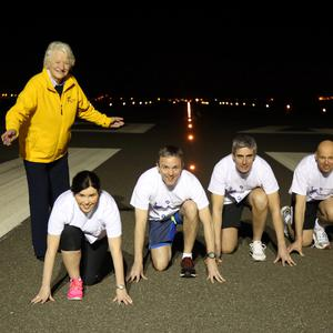 Dame Mary Peters is joined by Richard Gillan, managing partner at Grant Thornton (far right) and Grant Thornton partners Louise Kelly, Neal Taylor and Peter Legge on the runway of Belfast City Airport