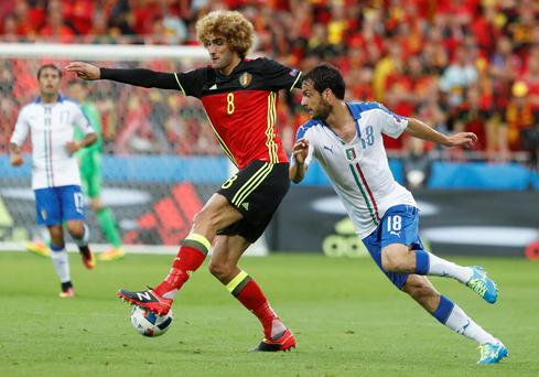 Italy's Marco Parolo, right, challenges Belgium's Marouane Fellaini during the Euro 2016 Group E soccer match between Belgium and Italy at the Grand Stade in Decines-Charpieu, near Lyon, France, Monday, June 13, 2016. (AP Photo/Laurent Cipriani)