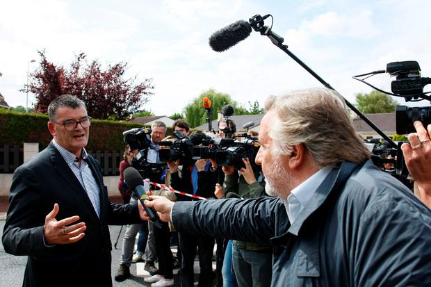 The Mayor of Magnanville, Michel Lebouc, answers journalists' questions on June 14, 2016 outside of the house in Magnanville where a man claiming allegiance to the Islamic State group killed a French policeman and his partner on the night of June 13. The man who knifed to death two police officials had a