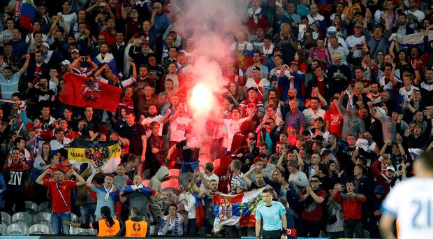 Russian fans celebrate and light a flare after Russia's Denis Glushakov scored, during the Euro 2016 Group B soccer match between Russia and Slovakia at the Pierre Mauroy stadium in Villeneuve dAscq, near Lille, France, Wednesday, June 15, 2016. (AP Photo/Frank Augstein)