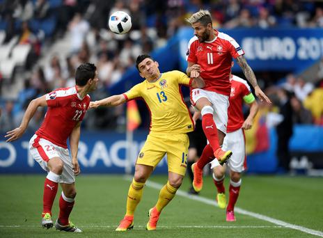 Switzerland's Valon Behrami, right, jumps for the ball with Romania's Claudiu Keseru during the Euro 2016 Group A soccer match between Romania and Switzerland at the Parc des Princes stadium in Paris, France, Wednesday, June 15, 2016. (AP Photo/Martin Meissner)
