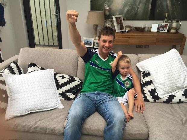 Green and bike army: Jonathan Rea and his son, Jake, show their support for Michael O Neill's boys at the Euros