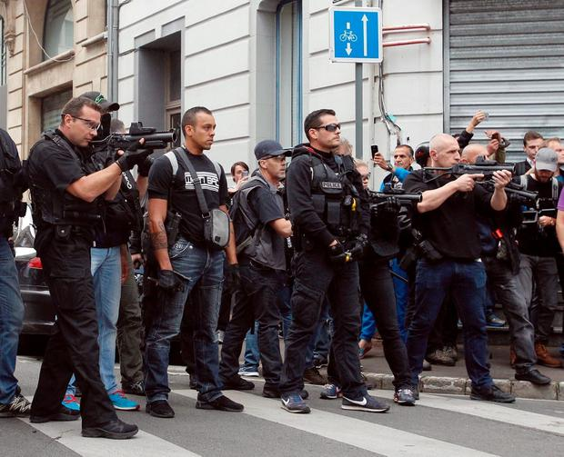 French Police aim their flash-ball guns to disperse English fans in downtown Lille, northern France, Wednesday, June 15, 2016, one day ahead of the Euro 2016 Group B soccer match against Wales in nearby Lens. Russia were playing Slovakia at the Pierre Mauroy stadium in Villeneuve dAscq, near Lille on Wednesday which raised the possibility of violence after clashes between supporters from the two countries at their previous match in Marseille last weekend. (AP Photo/Michel Spingler)