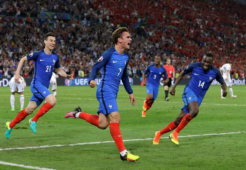 France's Antoine Griezmann, center, celebrates after scoring the opening goal during the Euro 2016 Group A soccer match between France and Albania at the Velodrome stadium in Marseille, France, Wednesday, June 15, 2016. (AP Photo/Thanassis Stavrakis)