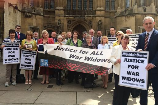Northern Ireland MPs with UDR widows outside the Houses of Parliament