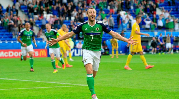 Northern Ireland's Niall McGinn celebrates scoring his sides second goal of the match during the UEFA Euro 2016, Group C match at the Parc Olympique Lyonnais, Lyon. Photo credit should read: Jonathan Brady/PA Wire.