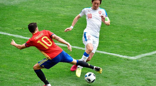 Spain's midfielder Cesc Fabregas (left) attempts a tackle on Czech Republic's midfielder Tomas Rosicky on Monday