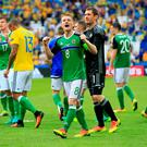 Making a fist of it: Northern Ireland's captain Steven Davis celebrates after his side's win over Ukraine