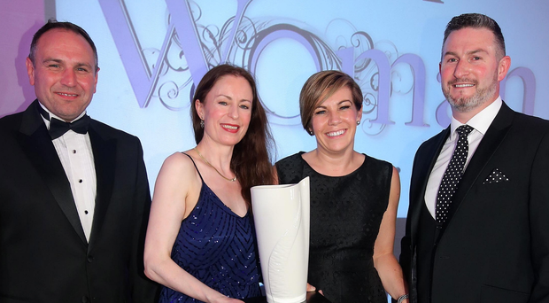Belfast Telegraph Woman of the Year Clodagh Dunlop (second right) with Chris Nelmes (left) of sponsors The Outlet, Belfast Telegraph Editor Gail Walker and Clodagh's husband Adrian