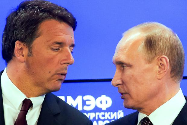 Russian President Vladimir Putin, right, and Italian Premier Matteo Renzi attend a signing ceremony of agreements on the sidelines of the St. Petersburg International Economic Forum in St. Petersburg, Russia, Friday, June 17, 2016. (AP Photo/Dmitry Lovetsky)
