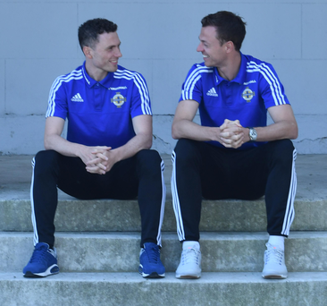 Brothers in arms: Northern Ireland siblings Jonny (right) and Corry Evans share a lighter moment in France