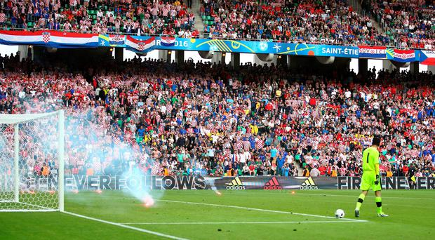 Czech Republic goalkeeper Petr Cech looks on as a flare lands on the pitch