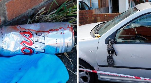 The scene of an overnight incident that left a bloodied footpath, a badly damaged car and broken windows in the Etna Drive area of north Belfast. Pic Kevin Scott