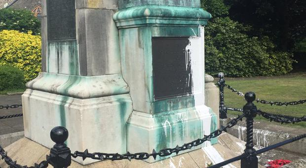 A paint attack on a war memorial in Larne has been branded 'appalling'